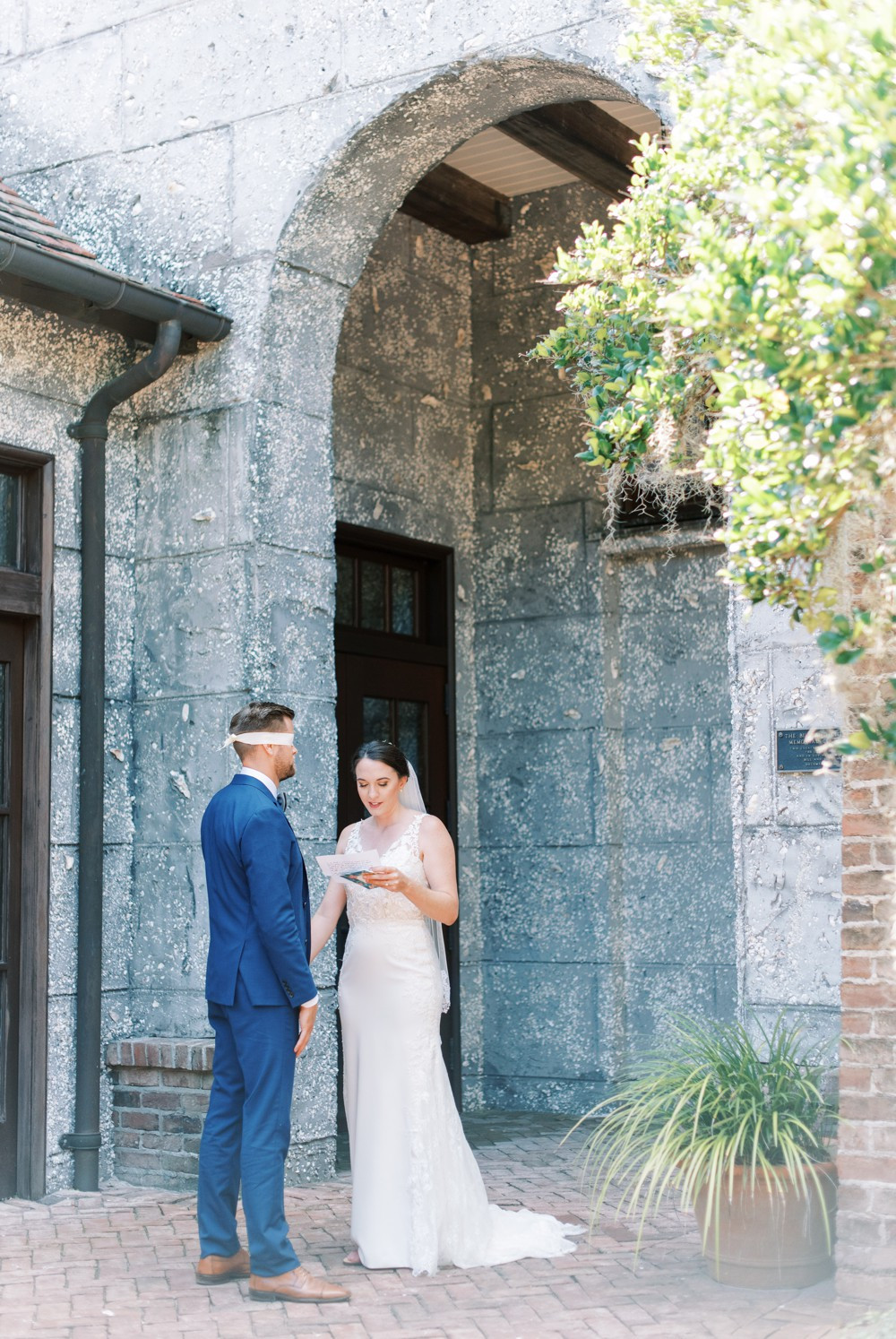 A Destination Wedding at St. Simons Island bride and groom kissing under a beautiful spanish moss tree