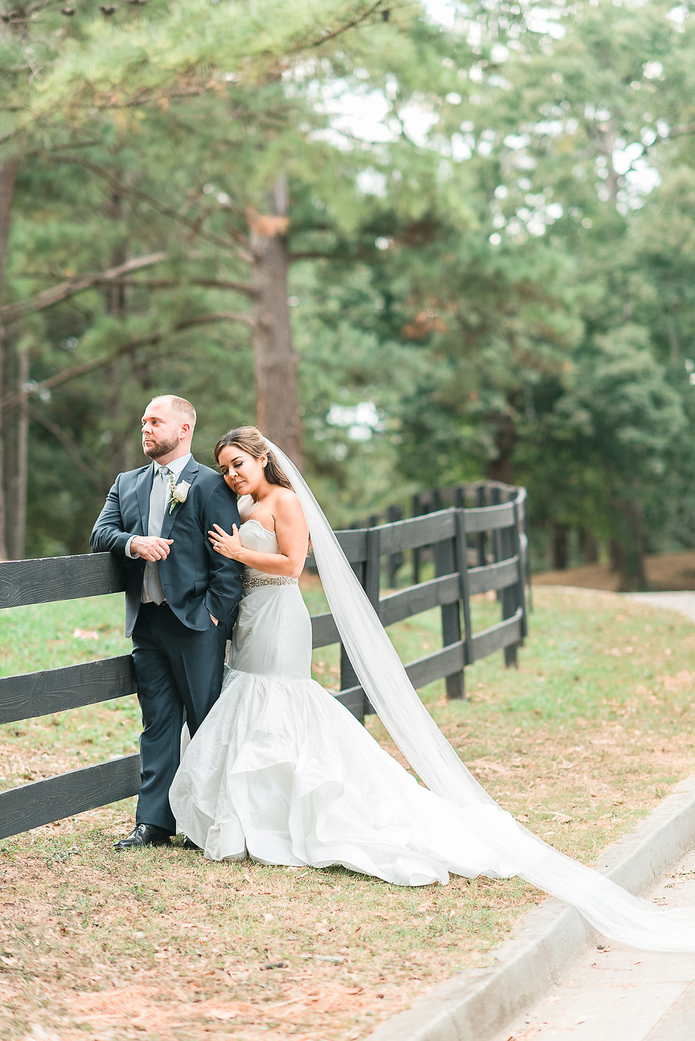 bride and groom holding hand at chastain horse park wedding mini horse