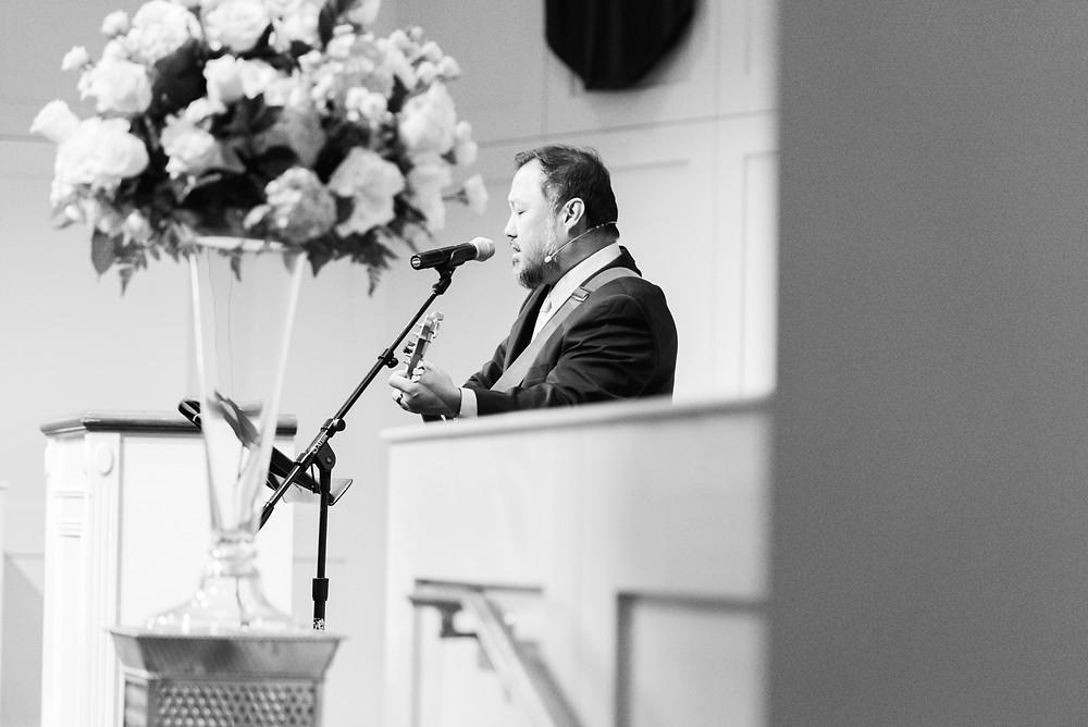 worship at a wedding playing acoustic guitar