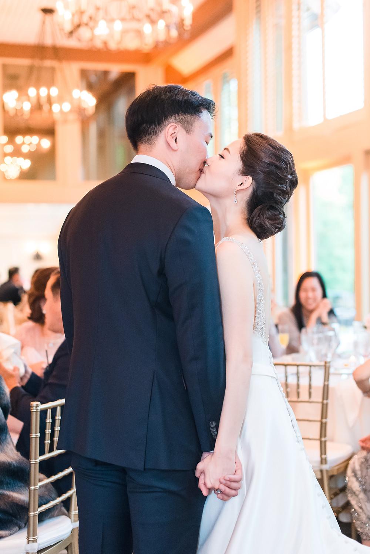 kissing as a new korean newlywed couple in atlanta georgia