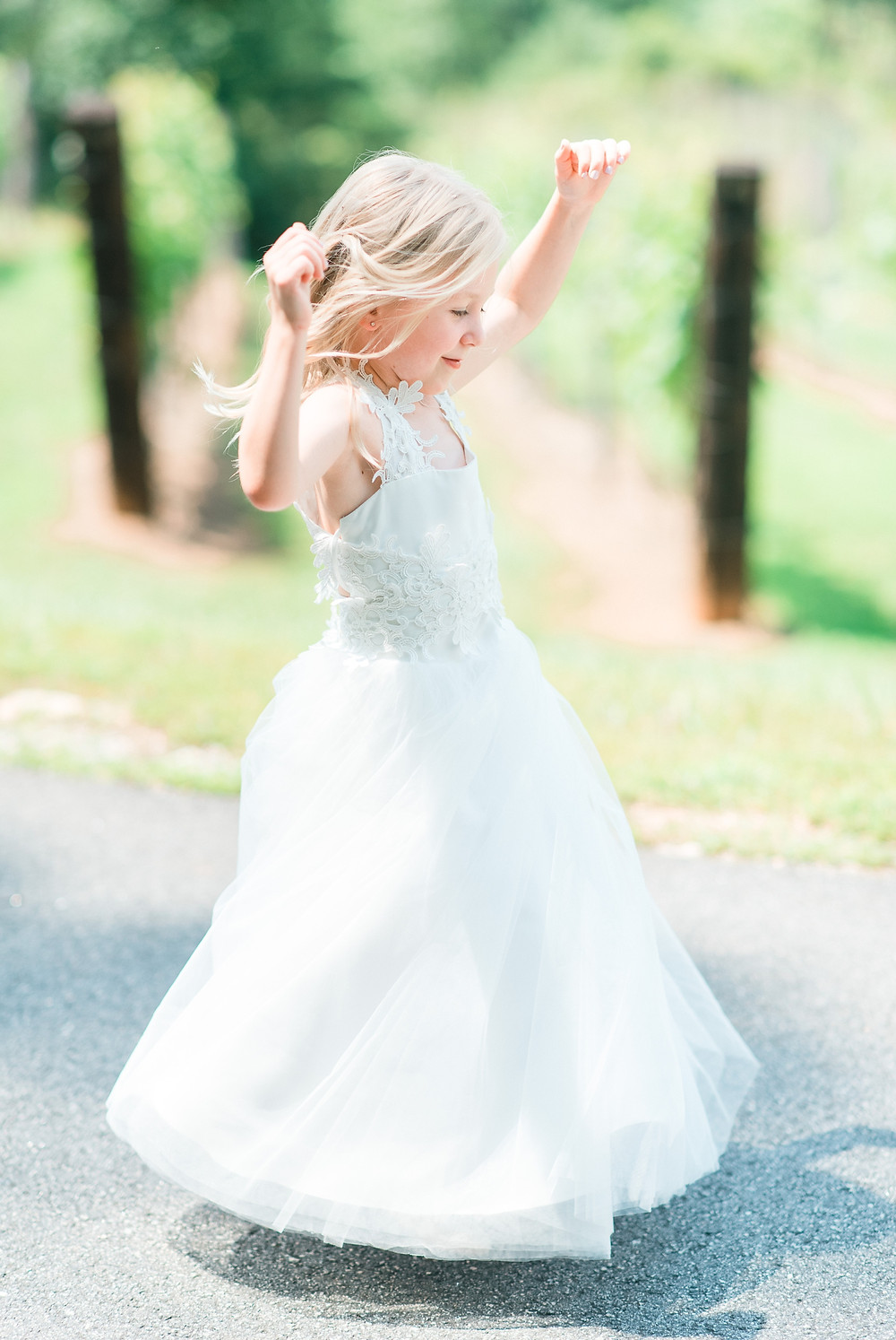 blue-mountain-vineyard-wedding-venue-outdoor-wedding-ceremony-pastel-wedding-color-palette-beautiful-flower-girl-dress-flower-girl-dancing