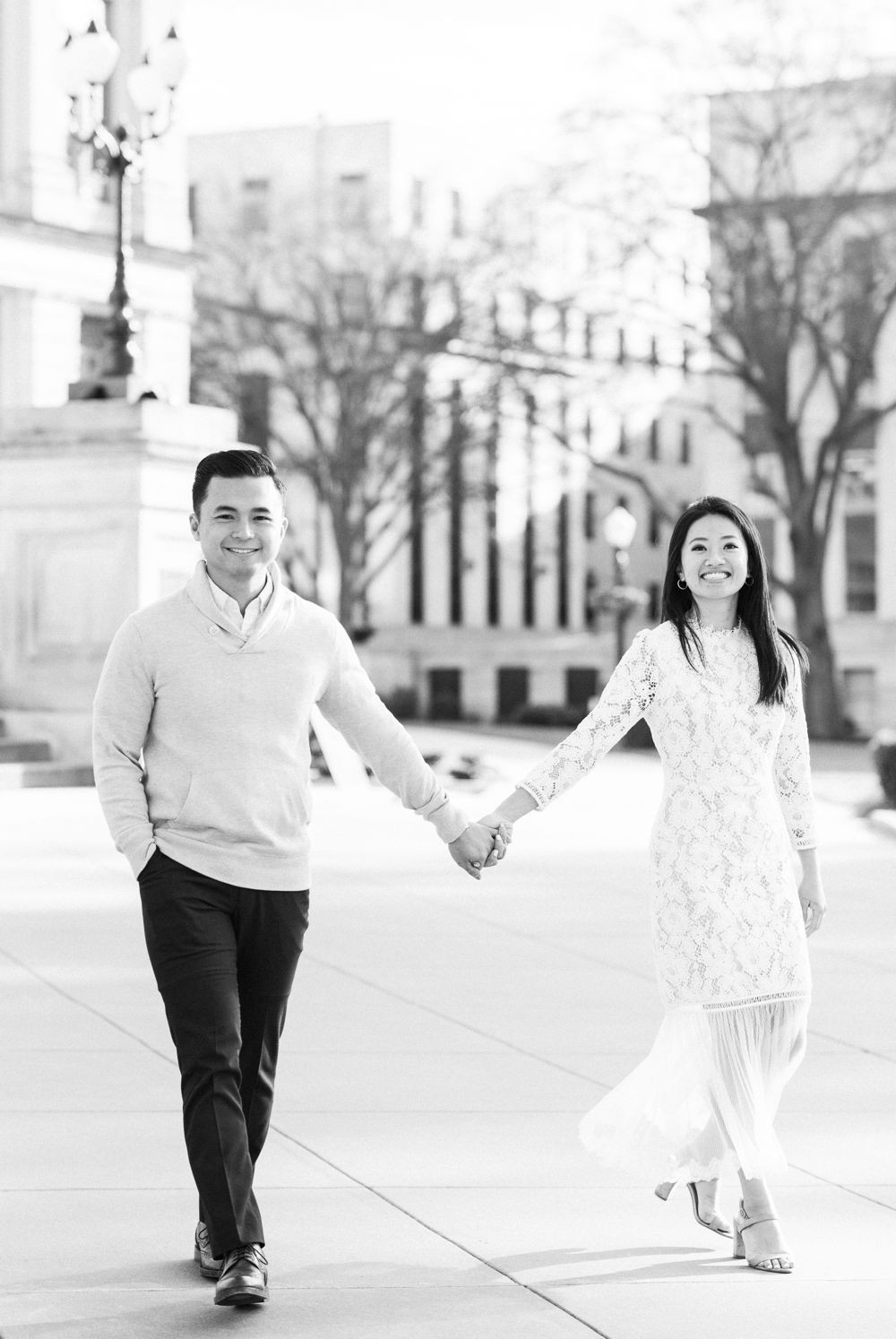 engagement session in downtown atlanta asian couple kissing forehead with white dress and j crew sweater