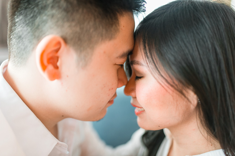 asian couple kissing in their home for an engagement session shot by asian wedding photographer in atlanta