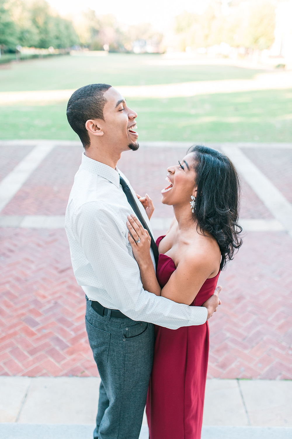 downtown atlanta engagement session african american couple kissing wearing red dress