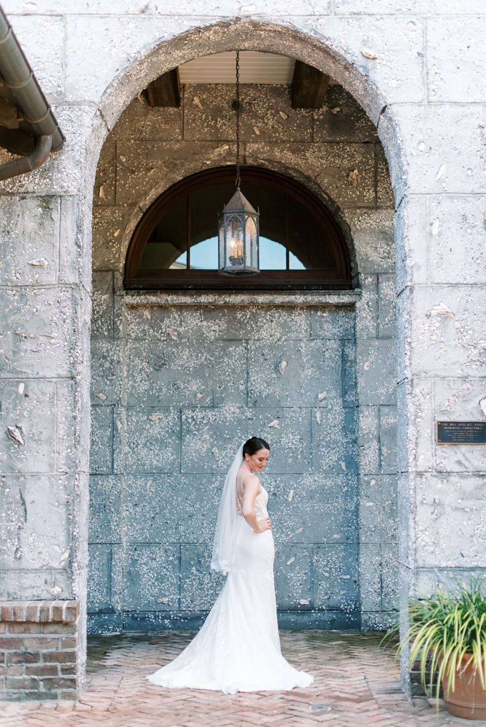 a bride posing under wesley methodist church a destination wedding at st simons island