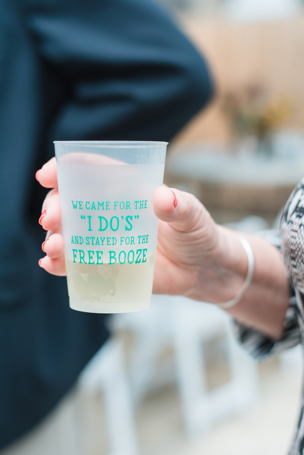 plastic cups with couple initials as wedding souvenir