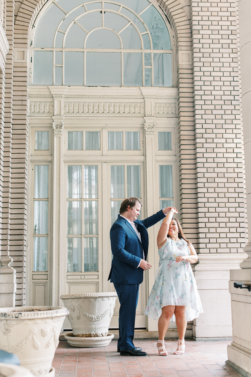 a bride and groom doing Georgian Terrace Hotel engagement session