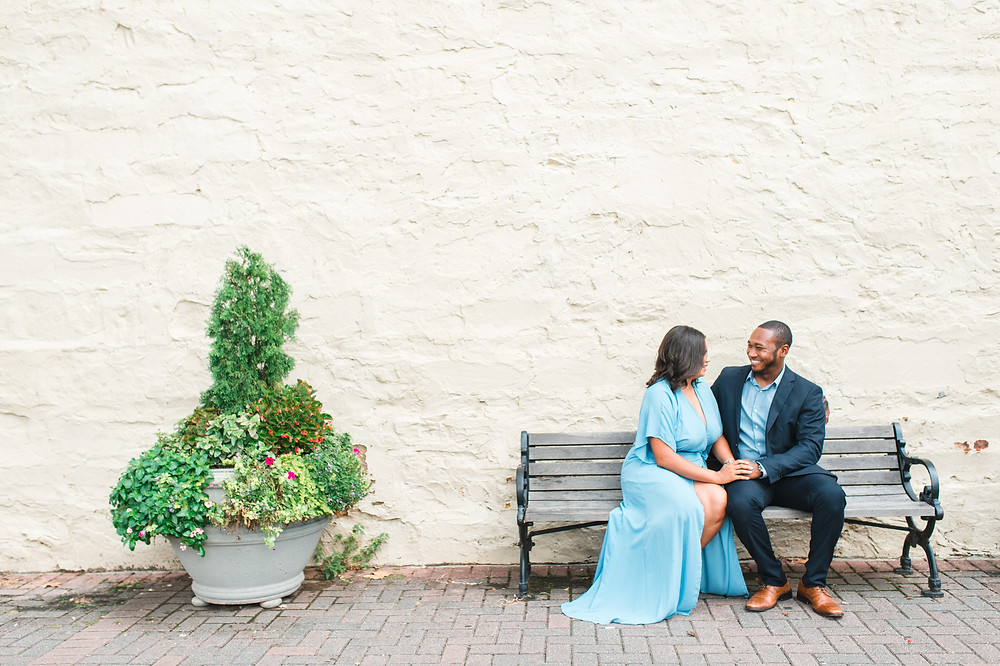 beautiful couple engagement session in downtown roswell holding hand