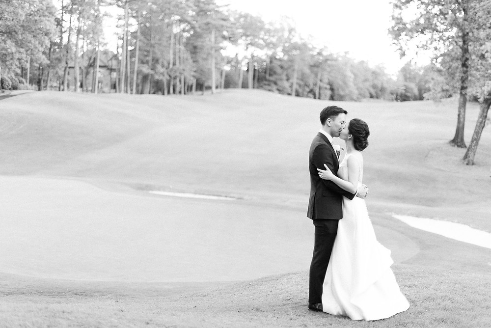 a beautiful couple wearing black tux and a line wedding dress got married at the country club of the south wedding