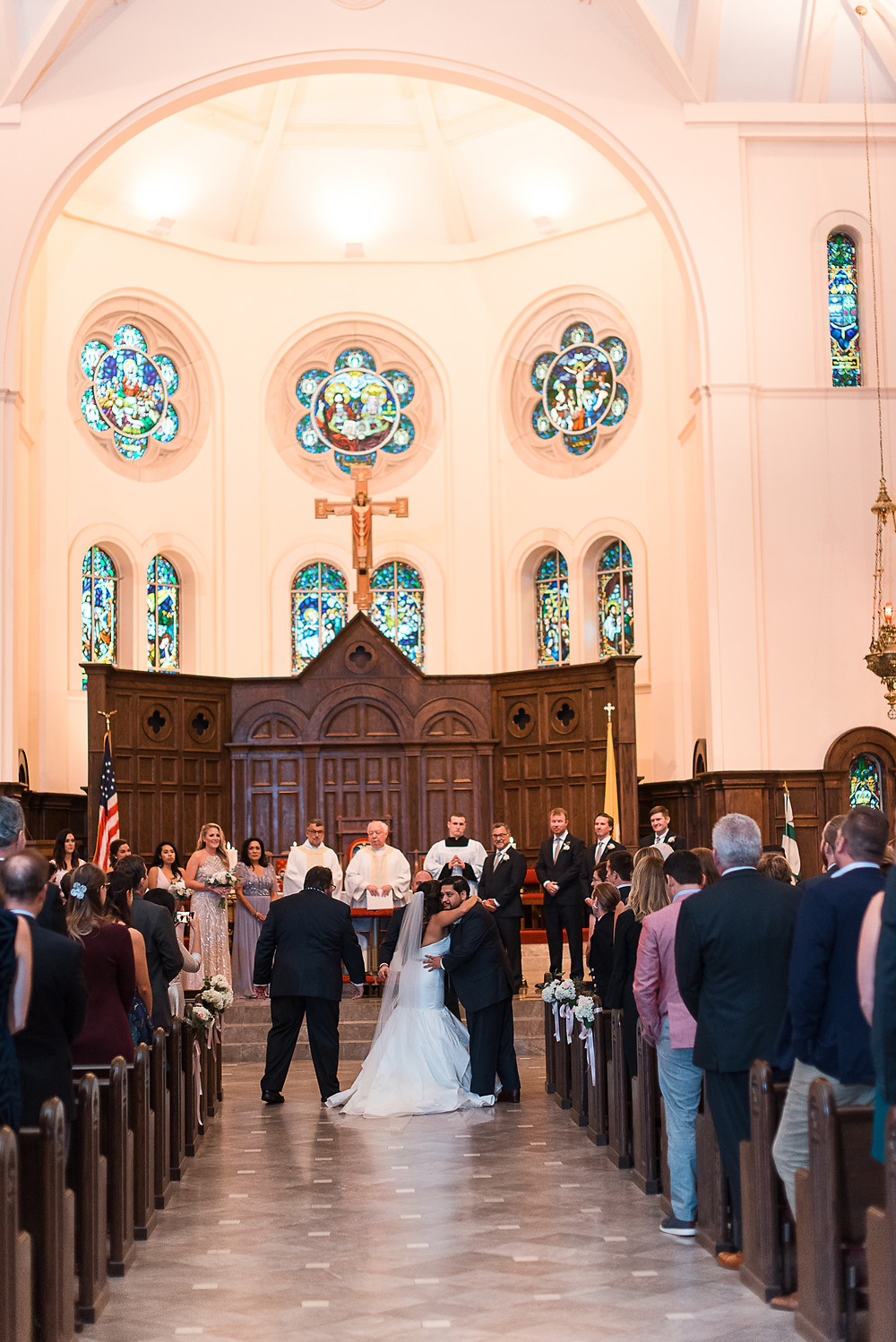 bride and groom getting married at HOLY SPIRIT CATHOLIC CHURCH WEDDING