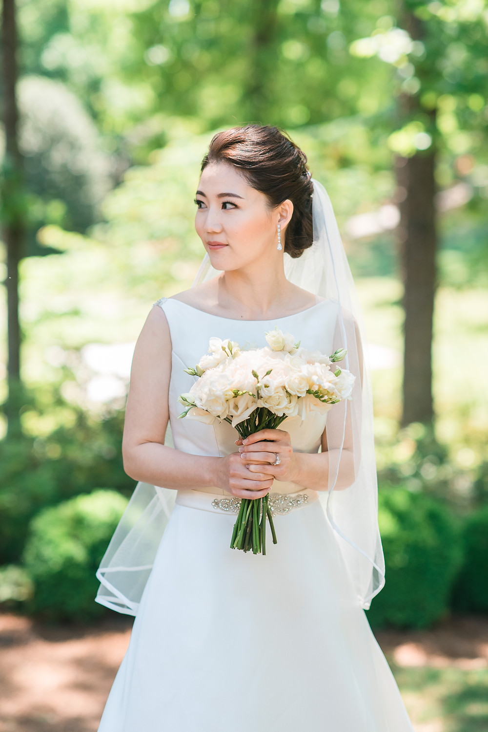 beautiful korean bride wearing white wedding dress getting married the country club of the south