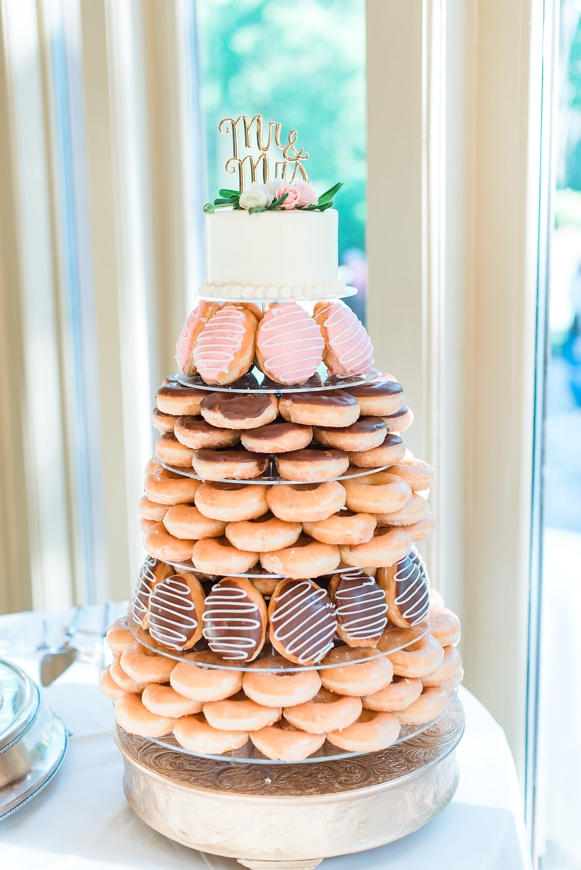 donut tower as their wedding cake at a luxury ballroom wedding