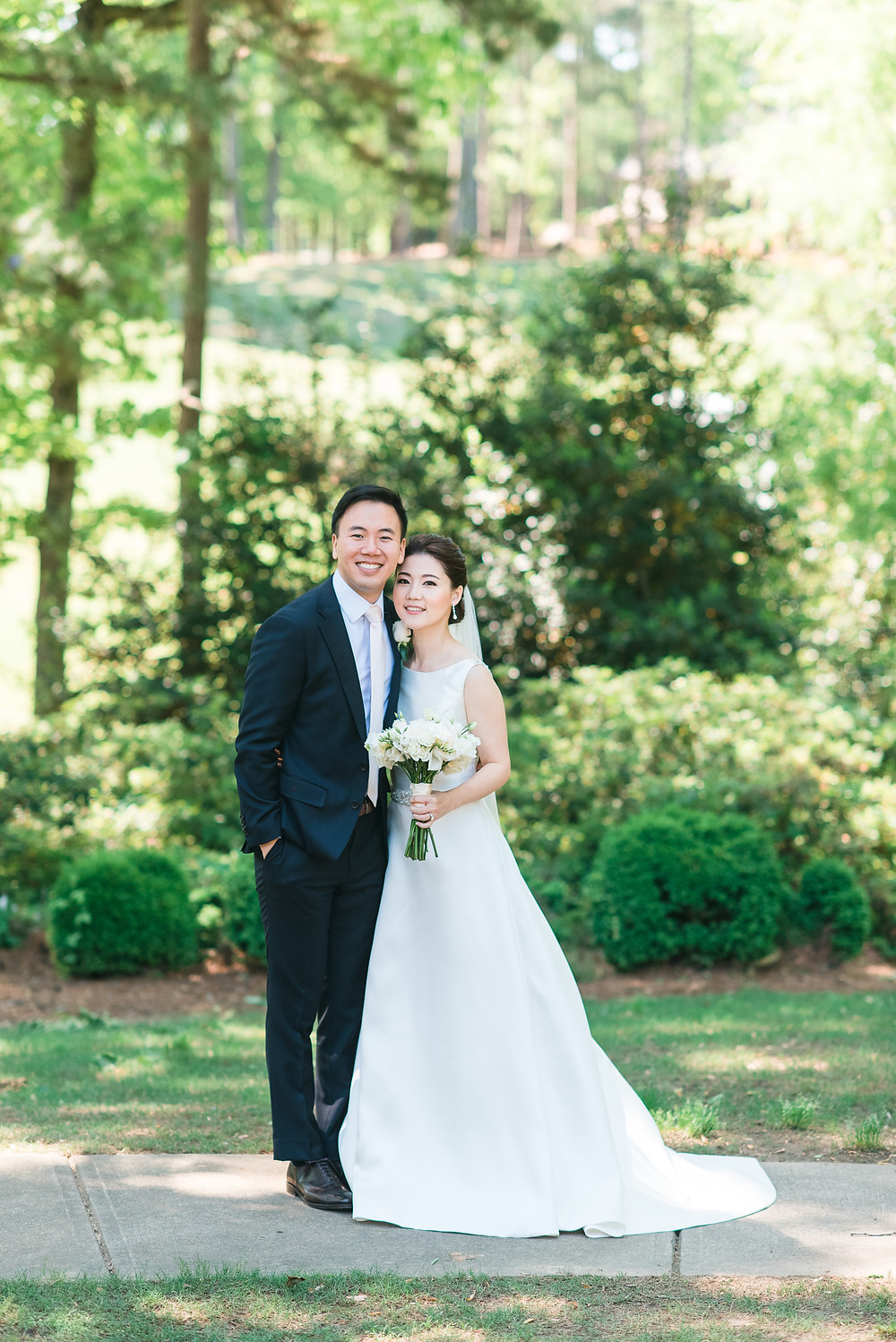 a beautiful korean couple in a modern, classy wedding at the country club of the south