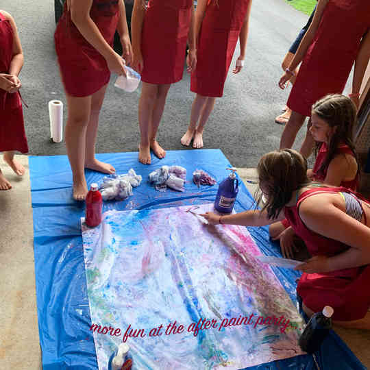 kids pouring paint, how fun!