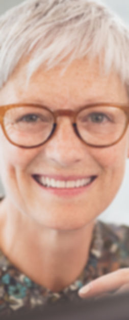 Older woman with glasses smiling - DFW Youth Secret Skin Care Membersips