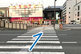 ② Cross the road and turn right.