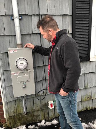 Tim-inspecting-electrical-box.jpg