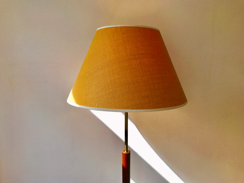 A very stylish teak and brass floor lamp from 1960s ca with new shade