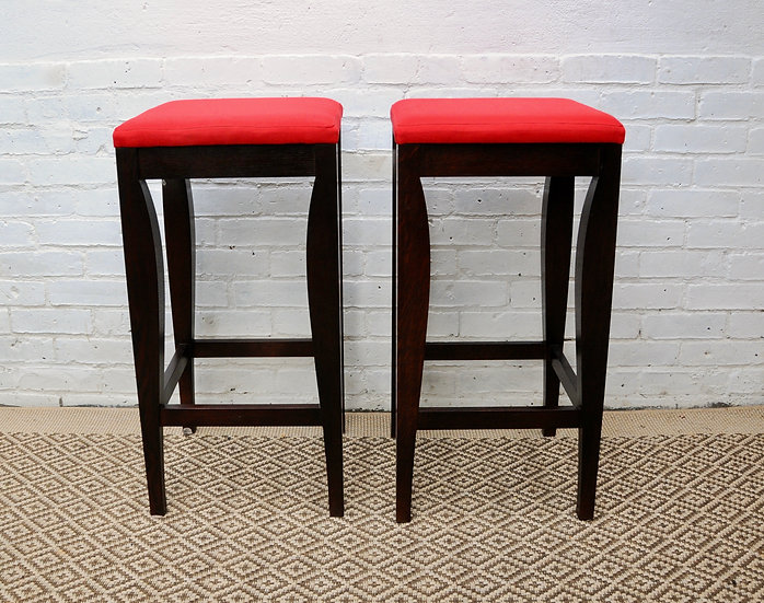 BAR STOOL WITH RED SEAT PAD AND EBONISED SUPPORTS