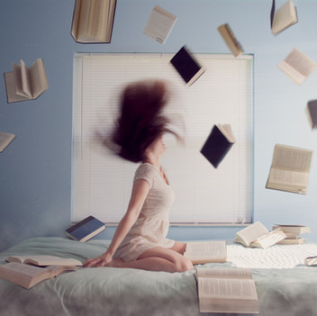 Girl Throwing Books in the Air