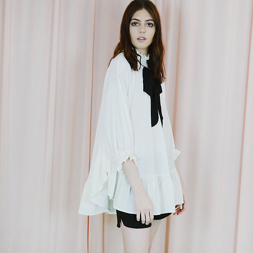 White Cape Top With High Neck And Bow