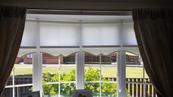 Roller Blinds in a bay with scalop 5