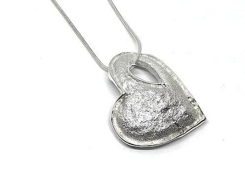 Pendentif coeur dans un coeur