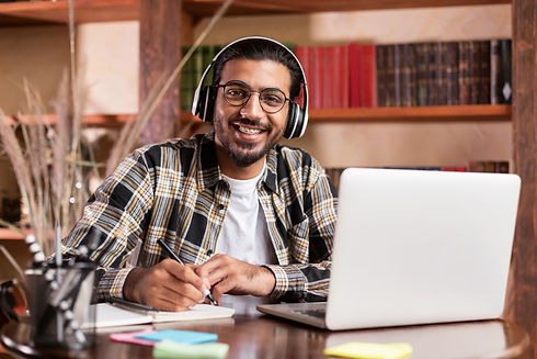 indian-student-guy-posing-at-laptop-lear