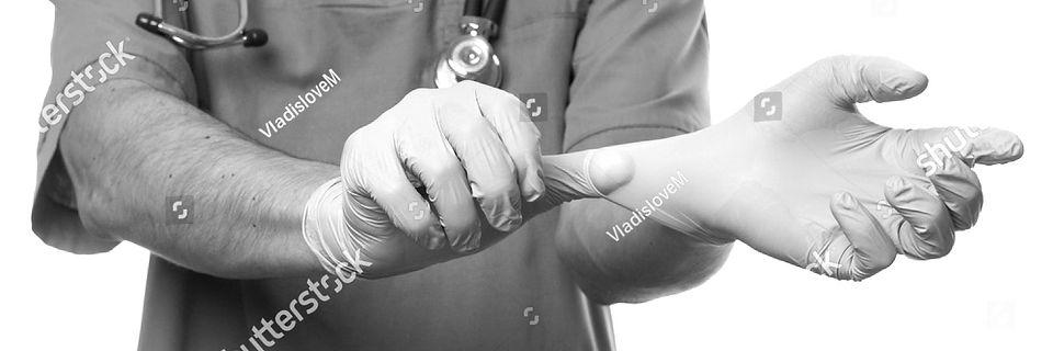 stock-photo-man-doctor-surgeon-putting-o