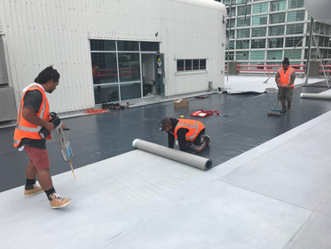 Fibertite being installed over existing butyl roofing