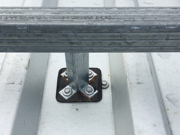 Structural post and rail with thermal break pad