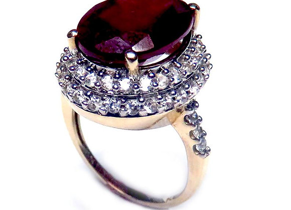 10K Gold Ring Set With a Dark Oval Cut Glass Filled Treated Ruby