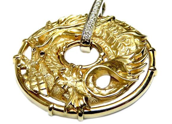 One of a kind 14k yellow gold dragon necklace including a gold chain.