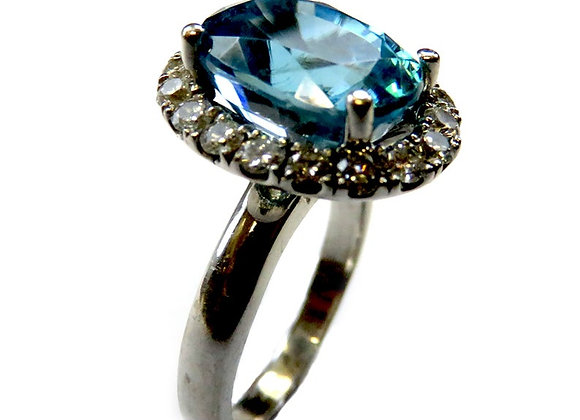 Genuine Swiss Blue Topaz and Diamonds Ring.