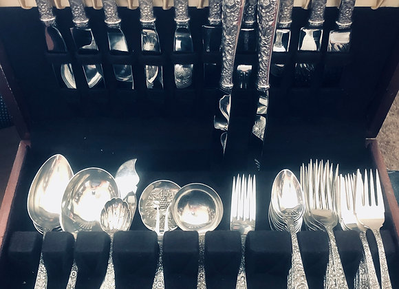 Sterling silver and stainless steel 59 piece Kirk and Son flatware set.