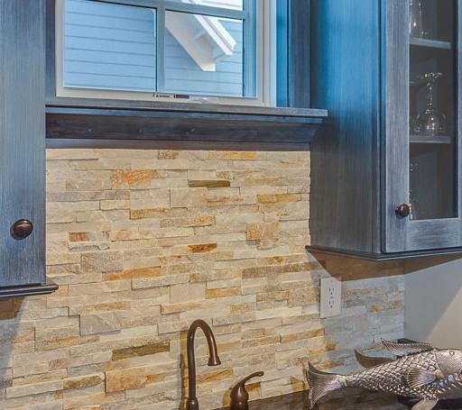 Custom wet bar with stone veneer back splash