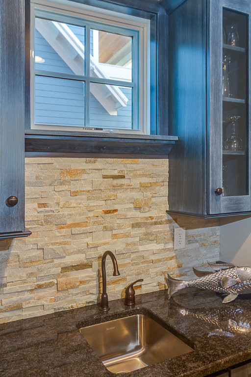 Custom wet bar with stone veneer back splash
