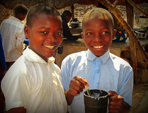 Schoolboys Share Smiles and Breakfast with Guests, Zambia