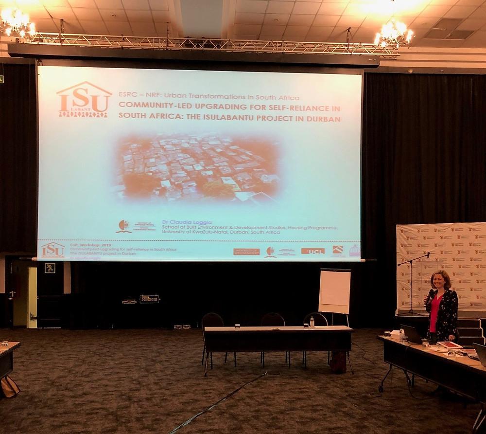 Dr Claudia Loggia presenting at the CoP Workshop