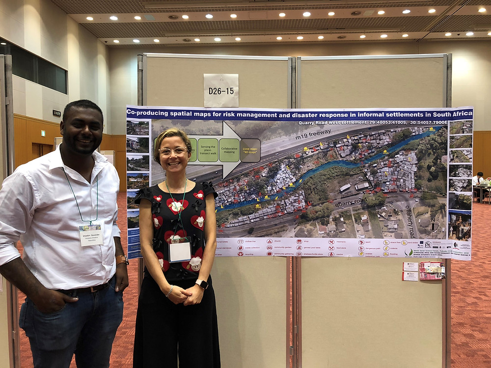 Dr Claudia Loggia and Mr Viloshin Govender presenting their poster at the forum.