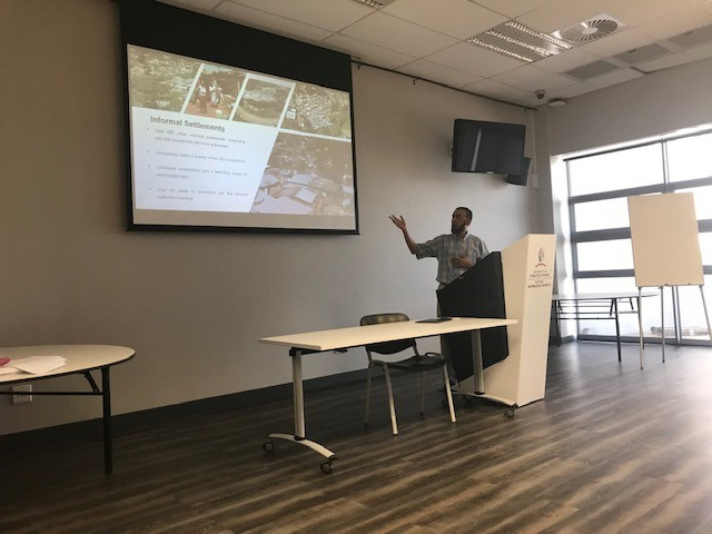 Faizal Seedat from eThekwini Municipality (Human Settlements Unit) presenting on informal settlement upgrading strategies.