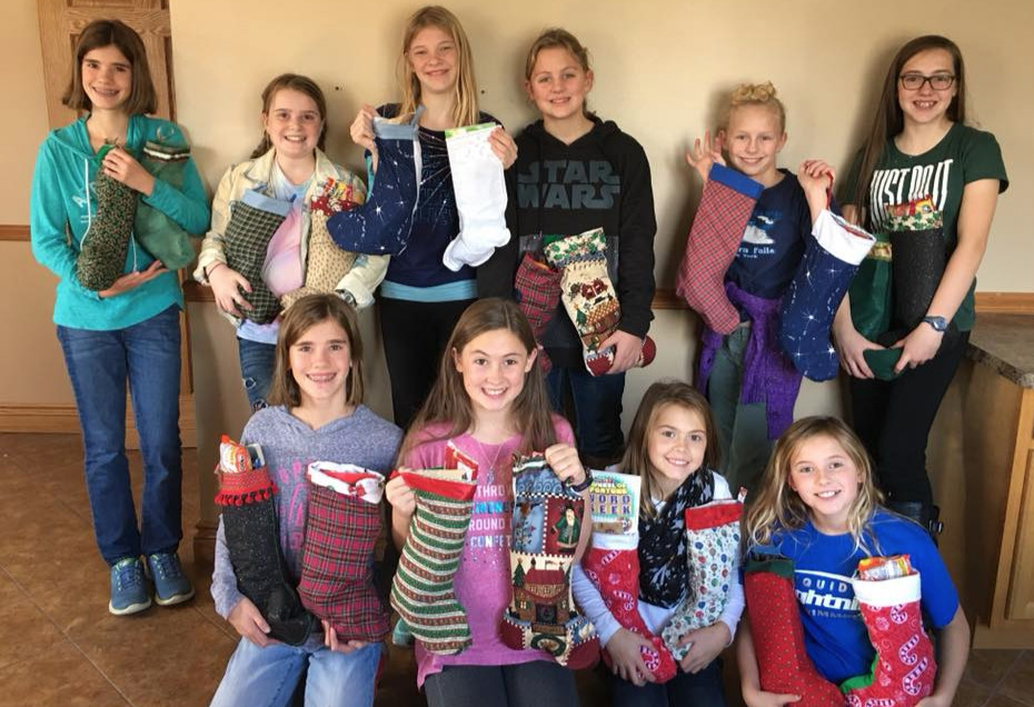 Filling Christmas stockings for US Troops.