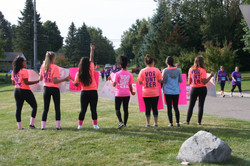 Cheering on breast cancer runners.