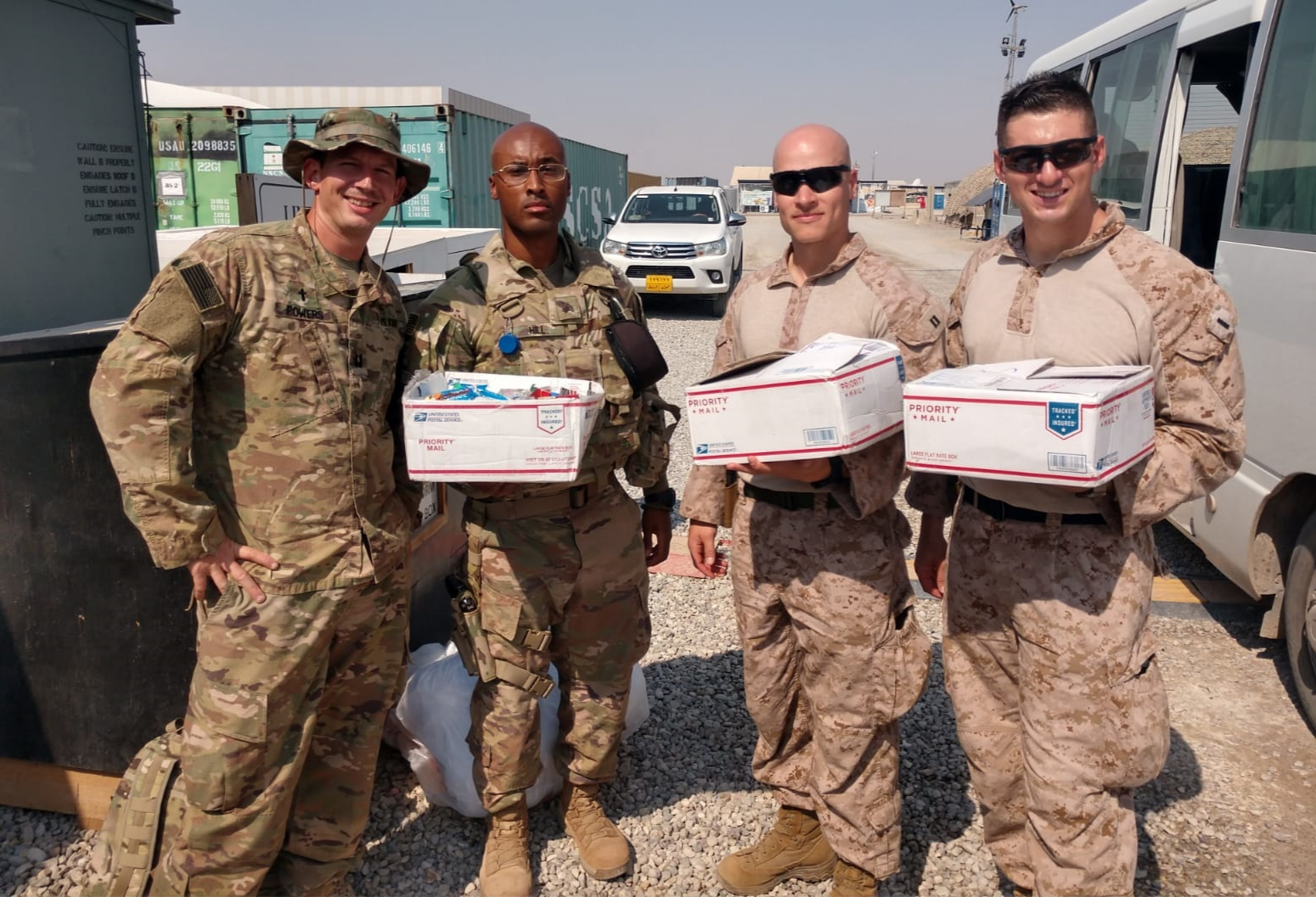 Deployed servicemen with care packages.