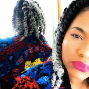 Girl with pink lipstick and braids