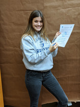 Abby signing for GFU Tennis