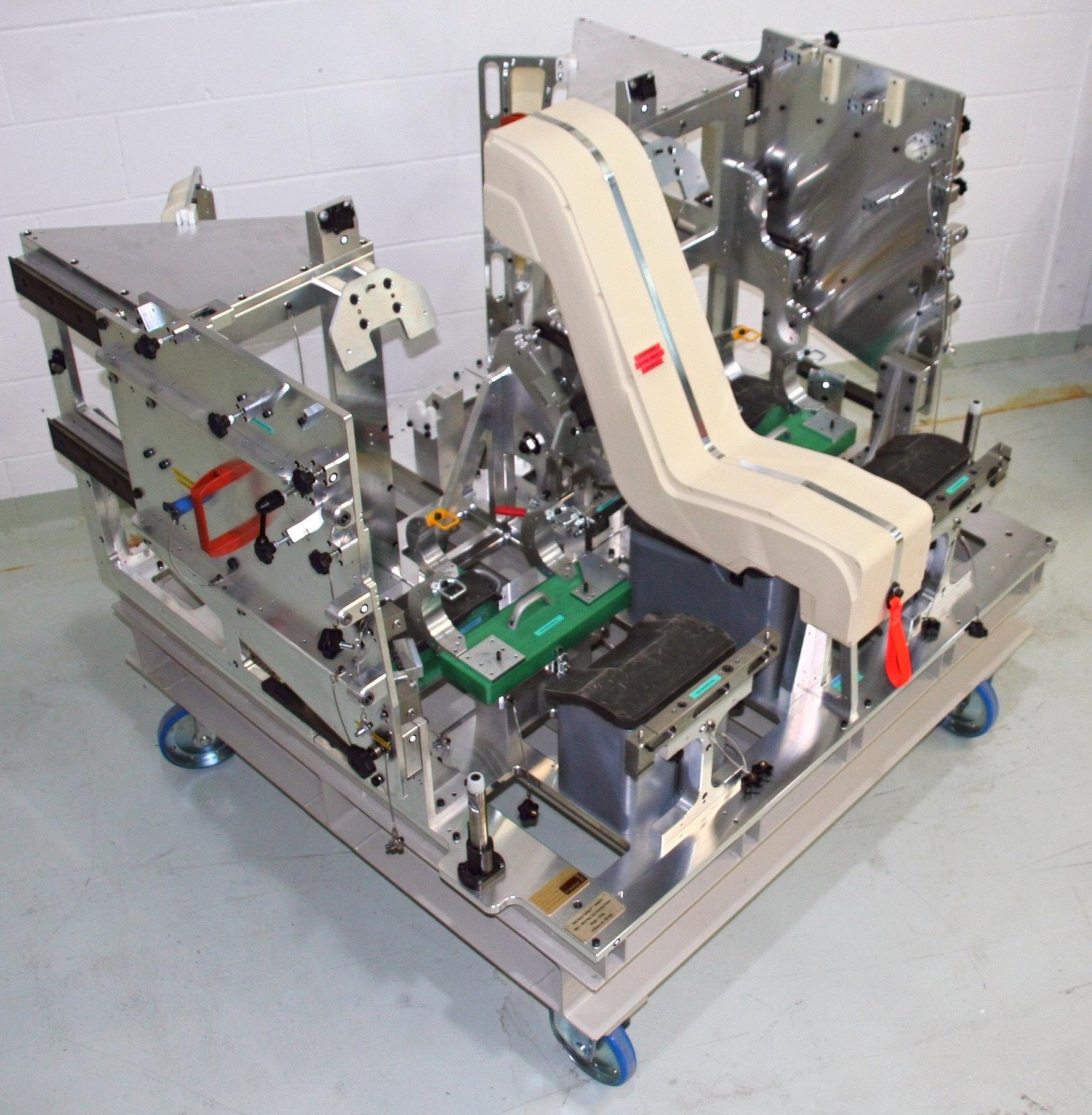 AUTOMOTIVE REAR SEAT FIXTURE