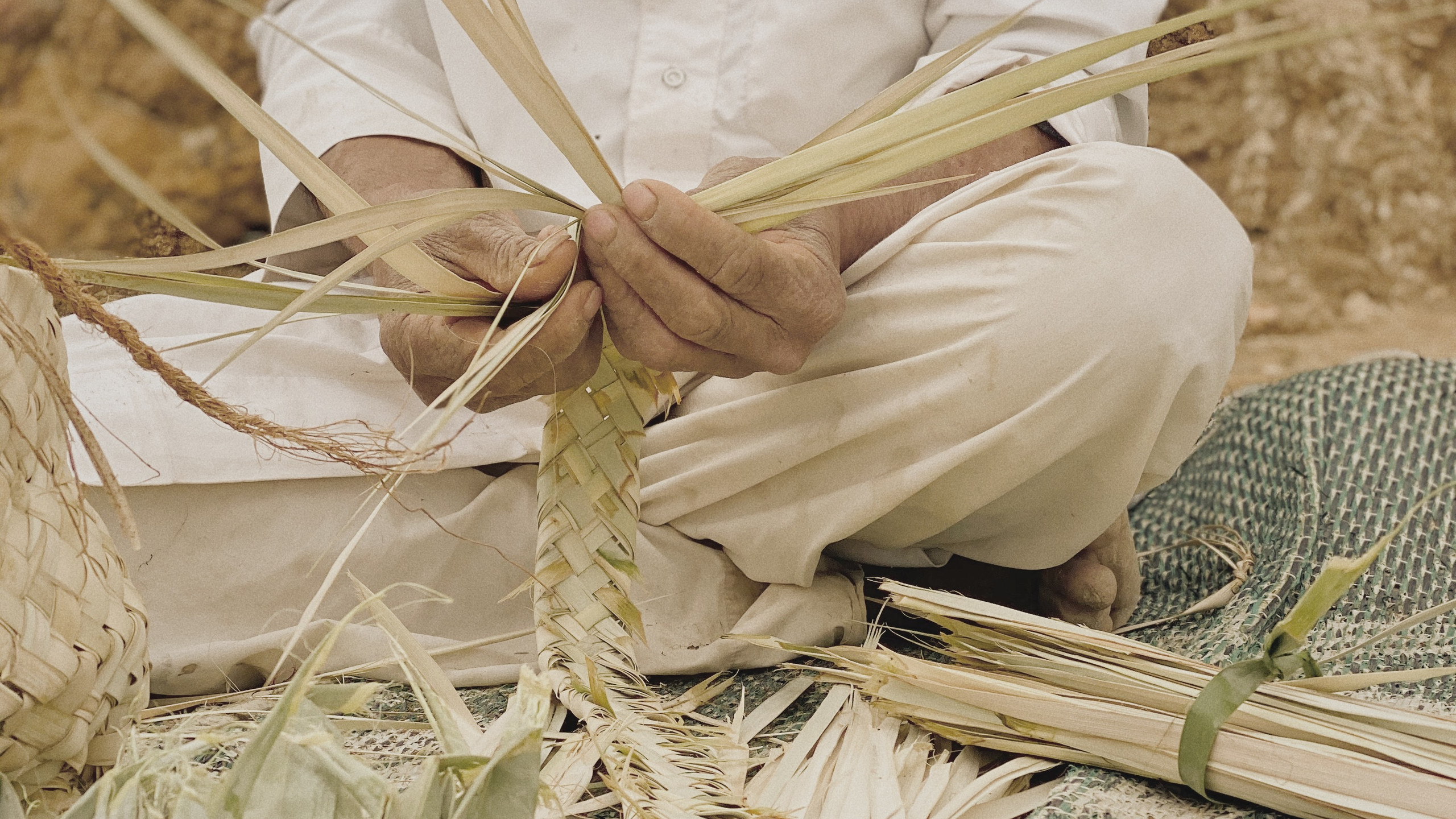 Making basket from dried palm