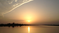 Sun-over-the-river-Gambia.png
