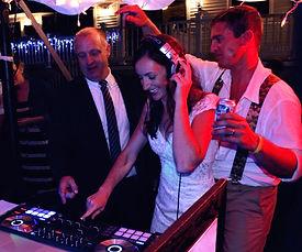 DJ Michael teaching a bride how to mix.